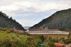 Bridge across the river Brazo Mayor flowing into the Cantabrian sea in San Vicente de la Barquera Stock Images