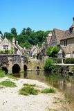 Bridge across river Bybrook, Castle Combe. Stone bridge over the river Bybrook with cottages to the rear, Castle Combe, Wiltshire, England, UK, Western Europe Stock Image