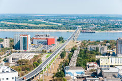 Bridge across river. In city, summer day Royalty Free Stock Images