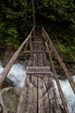 Bridge Across a River Creek. Wooden bridge over a flowing river on a hiking trail. Picture taken on a path to Widgeon Lake near Vancouver, British Columbia Royalty Free Stock Image