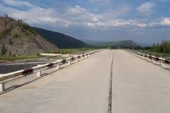 The bridge across the river. Stock Photos