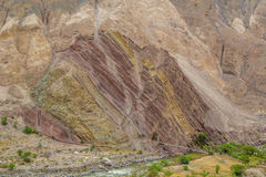 The bridge across the river at the multicolored cliffs Stock Photos