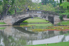 The bridge across a river. The bridge across a river in public park Stock Image