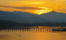 The bridge across river with reflective sunlight Stock Photo