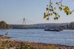 Bridge across the river Rhine near to Neuwied. With a river barge in front royalty free stock photos