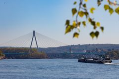 Bridge across the river Rhine near to Neuwied. With a river barge in front stock image
