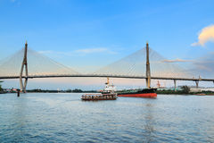 Bridge across  river with ships Stock Photography