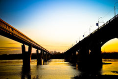 Bridge across the river at sunset Royalty Free Stock Image