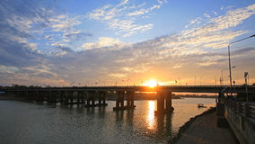 Bridge across river at sunset and twilight sky Stock Image