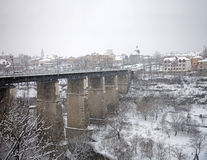Bridge across the river under snow Stock Photography