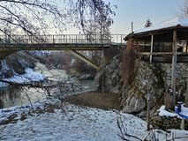 A bridge across the river. Bridge across a river in a village Royalty Free Stock Photography