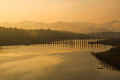 Bridge across the river. Wooden bridge across the river in the early hours. A beautiful picture Stock Photos