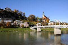 Bridge across Salzach river  with view of riverside Stock Image