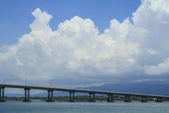 The Bridge across the sea and blue sky in Thailand Stock Photos