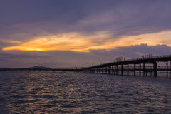 Bridge across the sea and sunset scene. Stock Image
