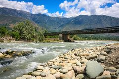 A bridge across sind river en-route Sonamarg. Road trip to Sonamarg from Srinagar on the Leh highway is very scenic with beautiful remote villages and towering Stock Photo