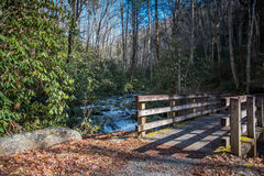 Bridge Across Swift Moving Creek Royalty Free Stock Images