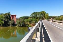 Bridge across Tanaro river in Italy. Royalty Free Stock Image