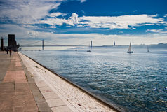 Bridge across water. Against cloudy sky Royalty Free Stock Photography