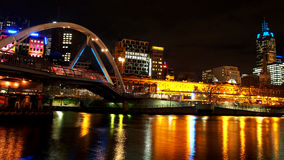 Bridge across the yarra river at night in Melbourne city, Australia. The bridge across yarra river between south bank and flinders street station at Melbourne Stock Photos