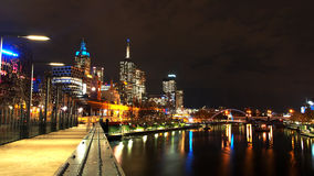 Bridge across the yarra river at night in Melbourne city, Australia. The bridge across yarra river between south bank and flinders street station at Melbourne Royalty Free Stock Images