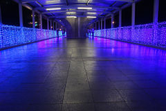 A bridge adorned with lights. Royalty Free Stock Photo