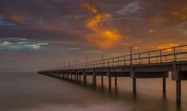 Bridge against sun setting clouds Royalty Free Stock Photo
