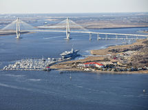 Bridge and aircraft carrier. Aircraft carrier in port in charleston, south carolina stock photos