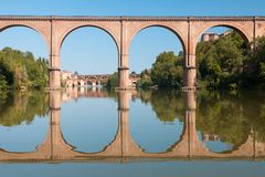 Bridge in Albi and its reflection. France Royalty Free Stock Photo