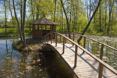 Bridge and alcove in the park. Small wooden bridge and alcove in the park Stock Photo