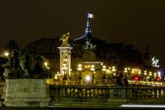Bridge of Alexander III in the night stock images