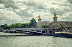 Bridge Alexander III under summer rainy sky Stock Image