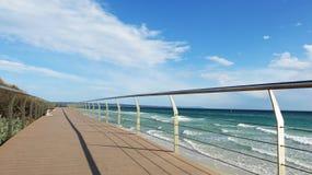 Bridge along the beach. Long bridge along the beach Royalty Free Stock Photography