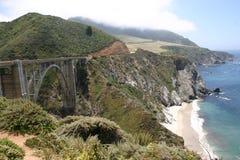 Bridge along rocky coastline Royalty Free Stock Photos