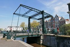 Bridge 222 Aluminium Brug. Over the canal Kloveniersburgwal. Centrum Amsterdam Was the first bridge in Amsterdam to feature a maintenance-free aluminium deck royalty free stock photo