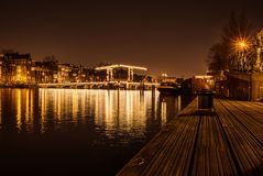 The bridge in Amstel Amsterdam in the night royalty free stock photos