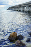 A bridge anf rock at tampa bay Royalty Free Stock Photography
