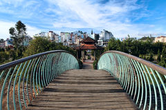 Bridge and arbor in a public park. Dalat. Vietnam Stock Image