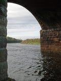 Bridge Arch. River flowing under a bridge Stock Images