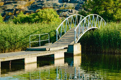 Bridge with arch over reed Royalty Free Stock Photography