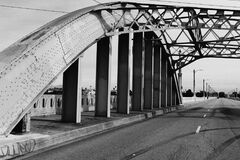 Bridge with arched metal structure