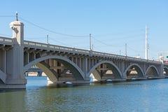 Bridge with arches across Tempe Lake in Arizona stock photo
