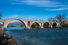Bridge of Arta in Greece. A stone bridge that crosses the Arachthos river in the west of the city of Arta. It has been rebuilt many times over the centuries Stock Photography