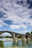 The Bridge of Arta is an old stone bridge that crosses the Arach Stock Photos