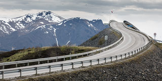 The bridge on the Atlantic Ocean Road with snow cap mountain ran. Ge, Norway Royalty Free Stock Images