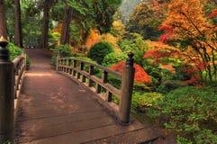 Bridge in autumn Stock Images