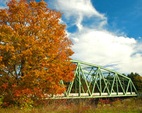 Bridge in autumn Stock Images
