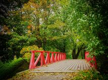 Bridge in autumn Stock Photos