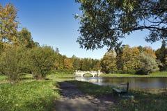 Bridge in the autumn park Stock Photos