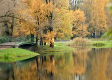 Bridge in autumn park Stock Photo